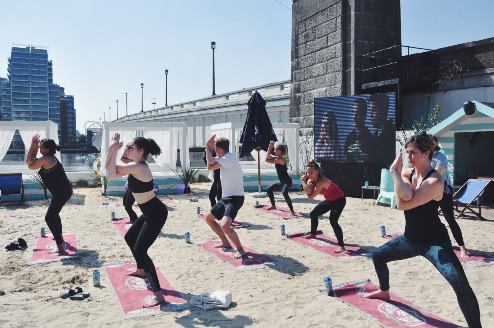 Life's an (Urban) beach:  Get stretchy with Pop Up Yoga at the Beach image