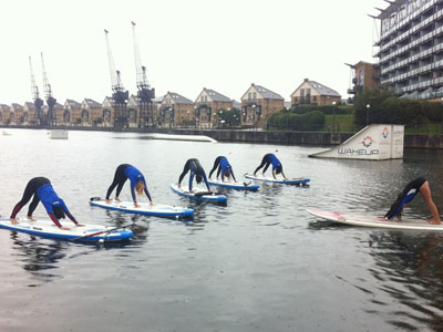 Do yoga on a paddleboard on water image