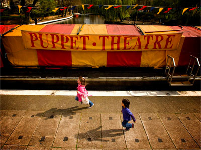 Watch a puppet show on a barge image