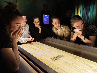 Play a modern game of shuffleboard image